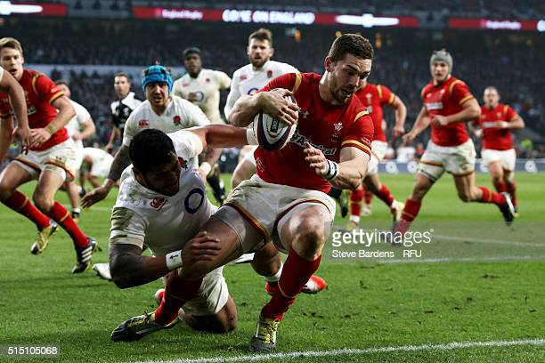 George North of Wales is tackled by Manu Tuilagi of England late in the game during the RBS Six Nations match between England and Wales at Twickenham...