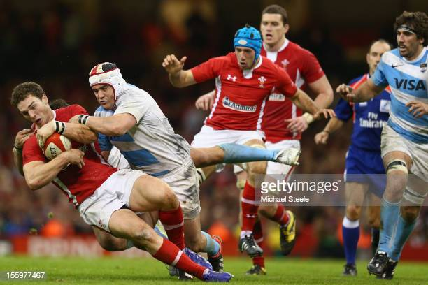 George North of Wales is tackled by Marcos Ayerza of Argentina during the Wales versus Argentina International match at the Millennium Stadium on...