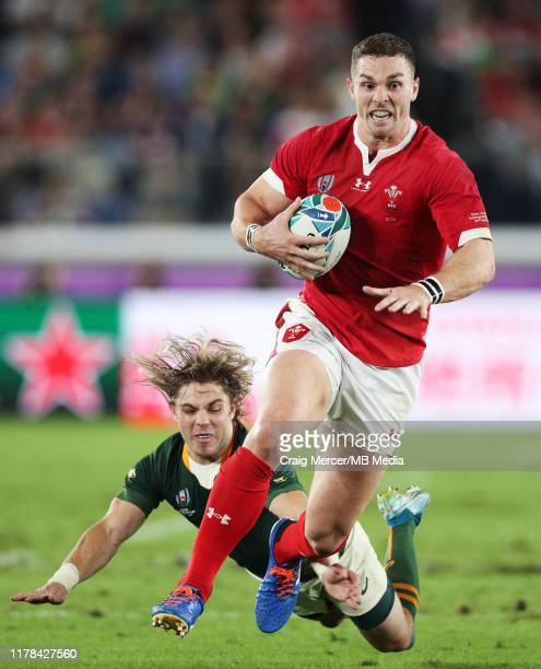 George North of Wales is tap tackled by Faf de Klerk of South Africa during the Rugby World Cup 2019 SemiFinal match between Wales and South Africa...
