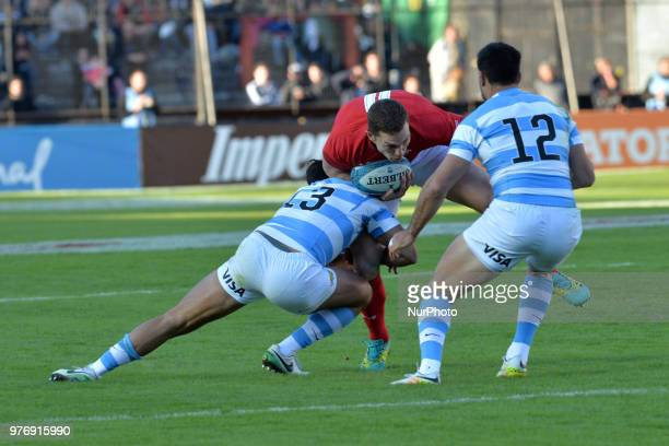 George North of Wales is wrapped up by the Argentine defence during the International Test Match between Argentina and Wales at the Brigadier...