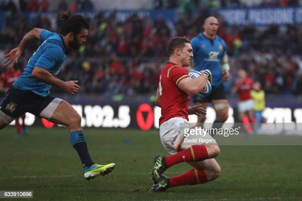 George North of Wales outpaces Luke McLean of Italy to score his team's third try during the RBS Six Nations match between Italy and Wales at the...