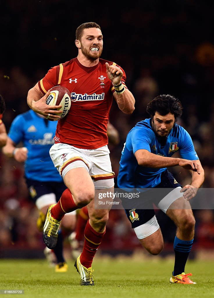 George North of Wales races away from Luke McLean to score during the RBS Six Nations match between Wales and Italy at the Principality Stadium on March 19, 2016 in Cardiff, Wales.