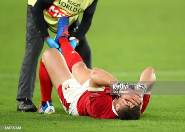 George North of Wales reacts as he receives medical treatment during the Rugby World Cup 2019 SemiFinal match between Wales and South Africa at...