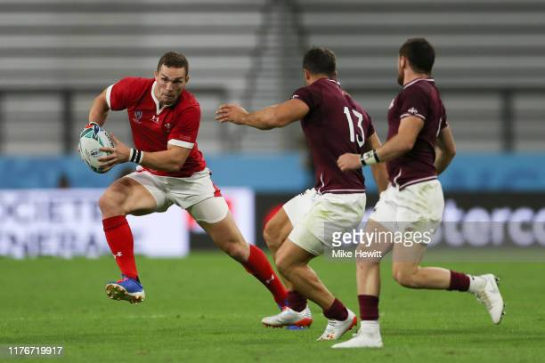 George North of Wales runs at by Davit Kacharava and Vasil Lobzhanidze of Georgia during the Rugby World Cup 2019 Group D game between Wales and...