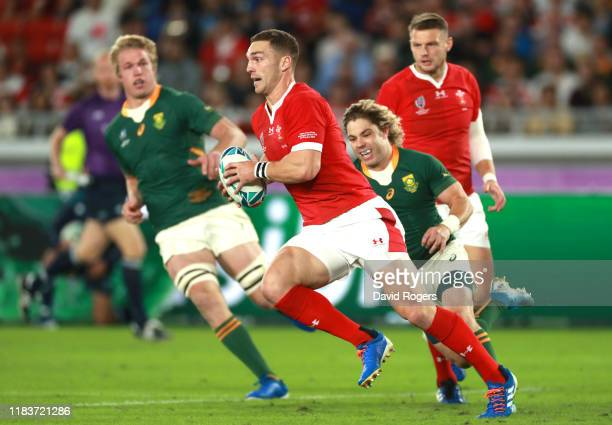 George North of Wales runs with the ball under pressure from Faf de Klerk of South Africa during the Rugby World Cup 2019 SemiFinal match between...