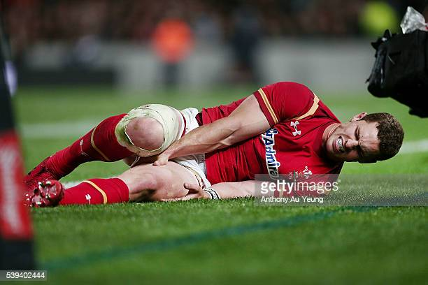 George North of Wales shows sign of pain after pulling a hamstring injury during the International Test match between the New Zealand All Blacks and...