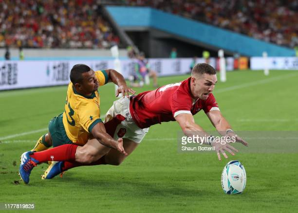 George North of Wales stretches for the ball as he is tackled by Kurtley Beale of Australia during the Rugby World Cup 2019 Group D game between...