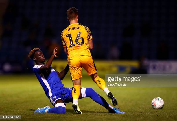 George Nurse of Newport County is challenged by Mikael Ndjoli of Gillingham FC during the Carabao Cup First Round match between Gillingham and...