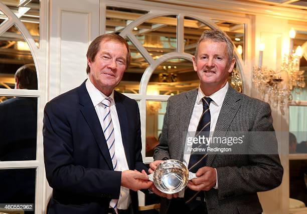 George O'Grady Chief Executive of The European Tour receives a commemorative gift from Derek Lawrenson Chairman of the Association of Golf Writers at...