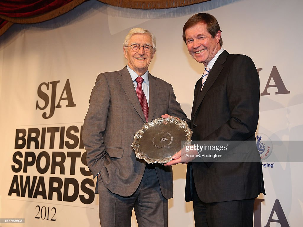 George O'Grady, Chief Executive of The European Tour, (right) receives the Sports Team Award from Sir Michael Parkinson during the SJA 2012 British Sports Awards at The Pavilion at the Tower of London on December 6, 2012 in London, England.