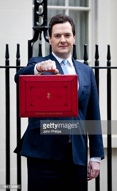 George Osborne, the Chancellor of the Exchequer, poses before presenting his annual budget to Parliament, outside 11 Downing Street on March 20, 2013...
