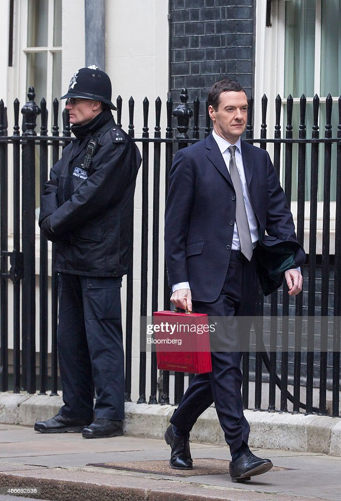 George Osborne, U.K. chancellor of the exchequer, carries the dispatch box containing the 2015 budget as walks past a police officer outside 10 Downing Street in London, U.K., on Wednesday, March 18, 2015. U.K. unemployment fell to its lowest level in more than six years and real pay growth accelerated in a boost for Osborne as he prepares to announce his final budget before the election. Photographer: Jason Alden/Bloomberg via Getty Images