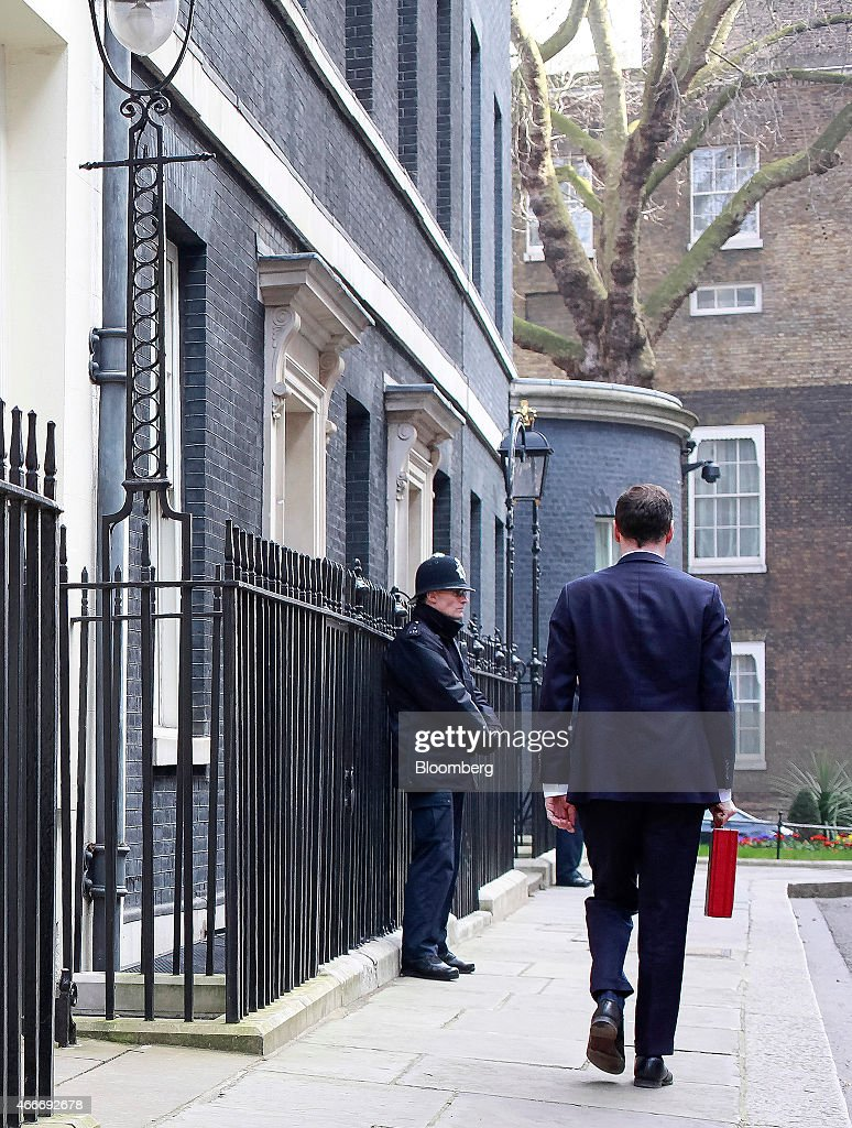 George Osborne, U.K. chancellor of the exchequer, carries the dispatch box containing the 2015 budget as he leaves 11 Downing Street in London, U.K., on Wednesday, March 18, 2015. U.K. unemployment fell to its lowest level in more than six years and real pay growth accelerated in a boost for Osborne as he prepares to announce his final budget before the election. Photographer: Jason Alden/Bloomberg via Getty Images