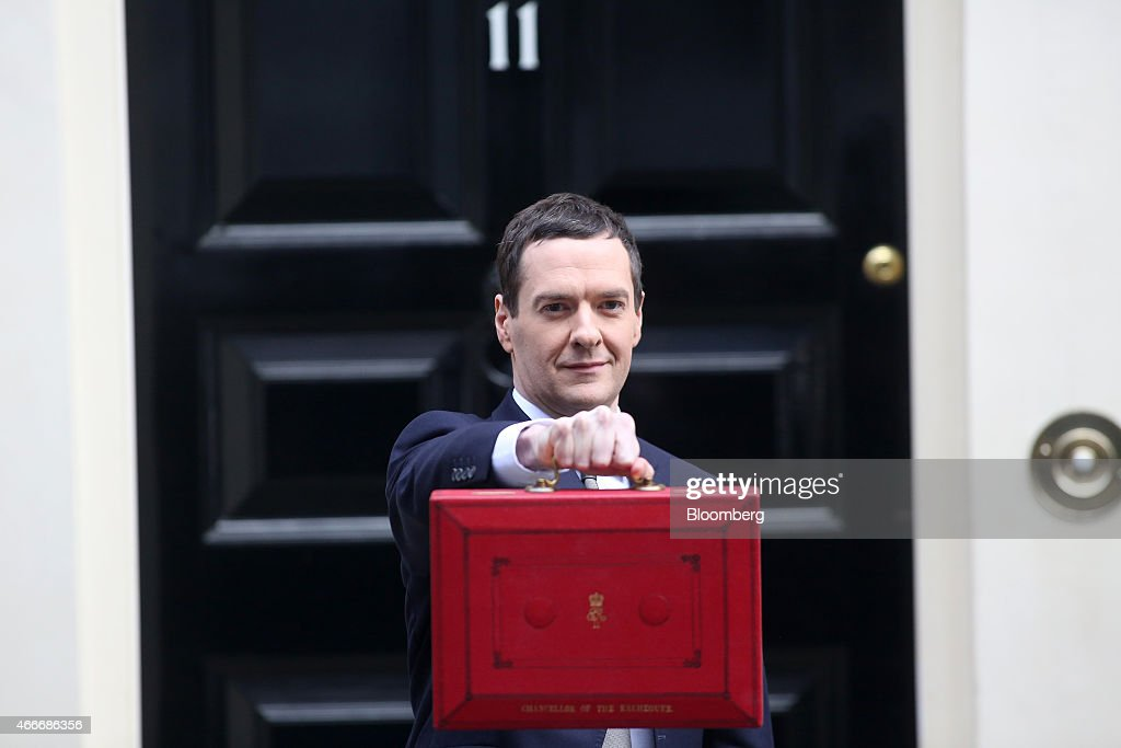 George Osborne, U.K. chancellor of the exchequer, holds the dispatch box containing the 2015 budget as he stands outside 11 Downing Street in London, U.K., on Wednesday, March 18, 2015. U.K. unemployment fell to its lowest level in more than six years and real pay growth accelerated in a boost for Osborne as he prepares to announce his final budget before the election. Photographer: Chris Ratcliffe/Bloomberg via Getty Images