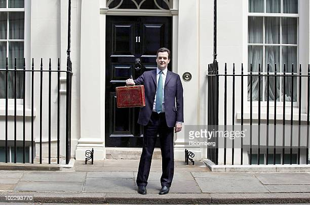 George Osborne UK chancellor of the exchequer holds the Gladstone dispatch box containing the emergency 2010 budget outside 11 Downing Street in...