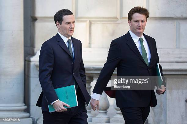 George Osborne UK chancellor of the exchequer left and Danny Alexander UK chief secretary to the treasury carry copies of the Autumn budget statement...