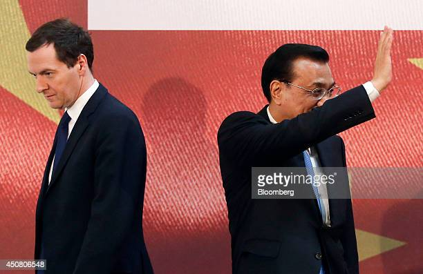 George Osborne UK chancellor of the exchequer left leaves the stage as Li Keqiang China's premier waves following the UK China Financial Forum at...