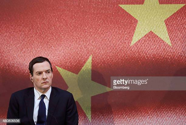 George Osborne UK chancellor of the exchequer listens through an earpiece during the UK China Financial Forum at Lancaster House in London UK on...