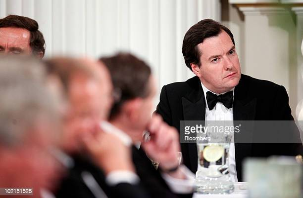 George Osborne UK chancellor of the exchequer listens to a speaker at Mansion House in London UK on Wednesday June 16 2010 Osborne is set to outline...