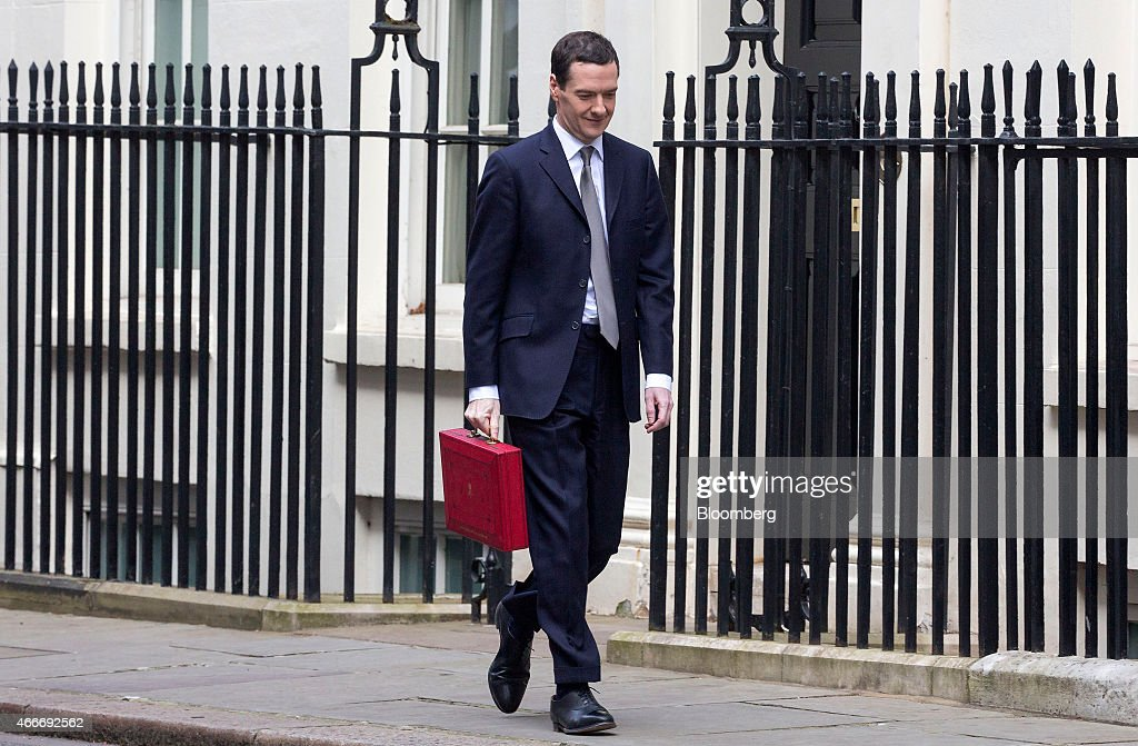 George Osborne, U.K. chancellor of the exchequer, smiles as he carries the dispatch box containing the 2015 budget as he leaves 11 Downing Street in London, U.K., on Wednesday, March 18, 2015. U.K. unemployment fell to its lowest level in more than six years and real pay growth accelerated in a boost for Osborne as he prepares to announce his final budget before the election. Photographer: Jason Alden/Bloomberg via Getty Images