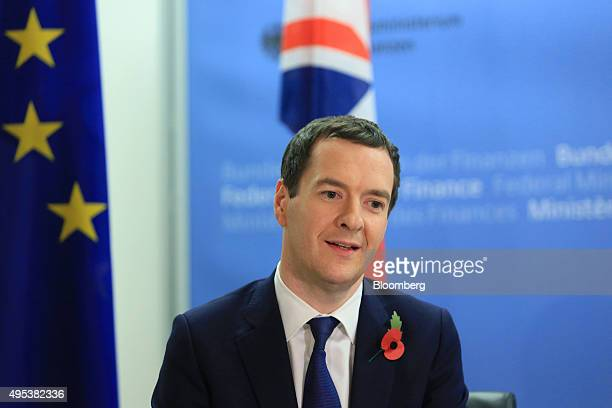 George Osborne UK chancellor of the exchequer speaks with Wolfgang Schauble Germany's finance minister not pictured at the ministry of finance in...