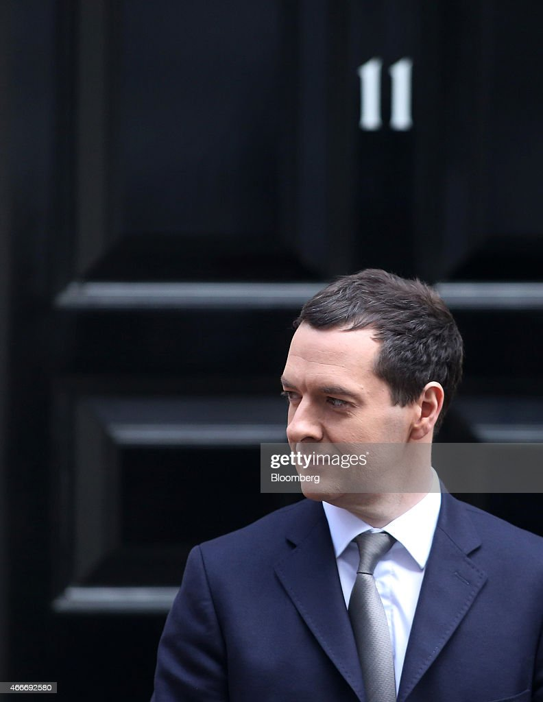 George Osborne, U.K. chancellor of the exchequer, stands outside 11 Downing Street in London, U.K., on Wednesday, March 18, 2015. U.K. unemployment fell to its lowest level in more than six years and real pay growth accelerated in a boost for Osborne as he prepares to announce his final budget before the election. Photographer: Chris Ratcliffe/Bloomberg via Getty Images