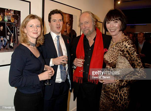 George Osborne with wife and Ed Victor with wife attend a private view of photographs dedicated to Sir Eric Clapton to celebrate his latest book...