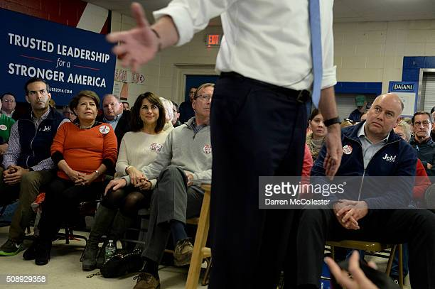 George P Bush and Columba Bush listen as Republican Presidential candidate Jeb Bush speaks at a town hall at Woodbury School February 7 2016 in Salem...