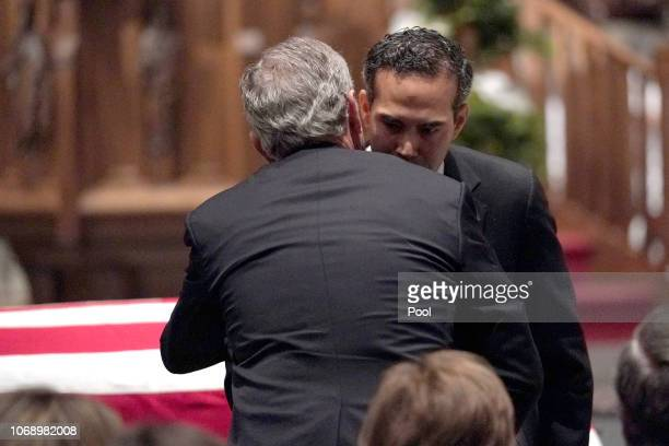 George P Bush embraces former President George W Bush after giving a eulogy for former President George HW Bush during a funeral service at St...