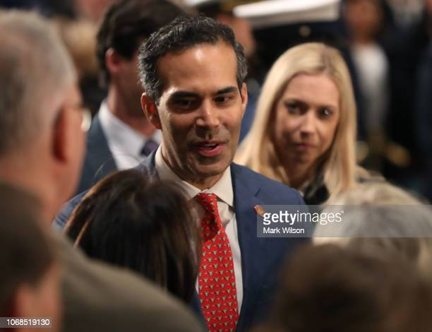 George P Bush greets mourners in front of the casket of his grandfather the late former President George HW Bush as he lies in state in the US...