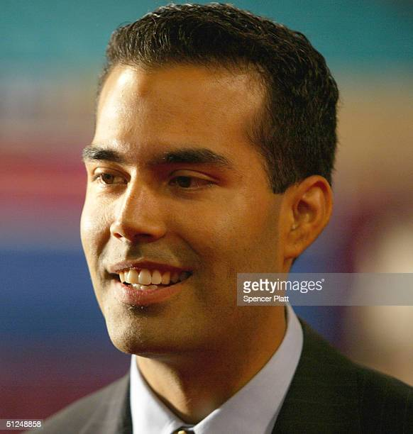 George P Bush the nephew of US President George W Bush speaks to the media on the floor of the Republican National Convention at Madison Square...