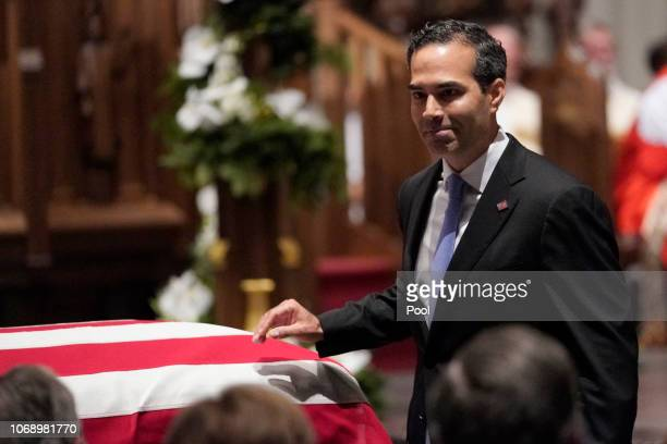 George P Bush walks past the casket of former President George HW Bush after giving a eulogy at St Martin's Episcopal Church on December 6 2018 in...