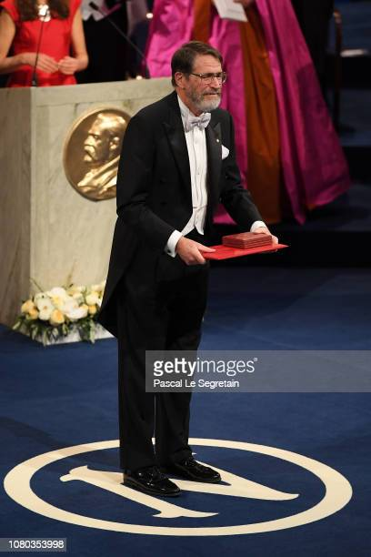 George P Smith laureate of the Nobel Prize in Chemistry acknowledges applause after he received his Nobel Prize from King Carl XVI Gustaf of Sweden...
