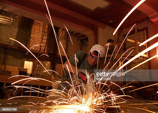 George Pajka creates sparks as he cuts a metal stud inside the former Moorpark Playhouse on High Street in Moorpark Thousand Oaks developer Larry...