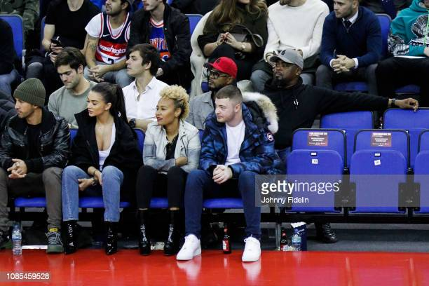George Panayiotou, Amy Jackson, actress, Emeli Sande, singer and former player Patrice Evra during the NBA game against Washington Wizards and New...