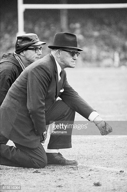 "George ""Papa Bear"" Halas, head coach of the Chicago Bears and a tradition in professional football, clenches his gloved fist in determination as he..."