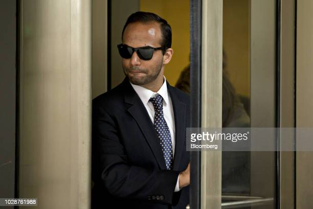 George Papadopoulos former campaign adviser for US President Donald Trump walks out of federal court in Washington DC US on Friday Sept 7 2018...