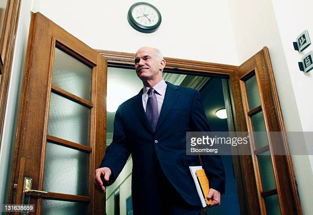 George Papandreou, Greece's prime minister, arrives for a cabinet meeting at the Greek parliament in Athens, Greece, on Sunday, Nov. 6, 2011....