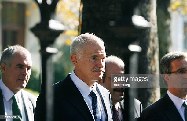 George Papandreou, Greece's prime minister, center, leaves the Presidential Palace after meeting with Karolos Papoulias, Greece's president, in...