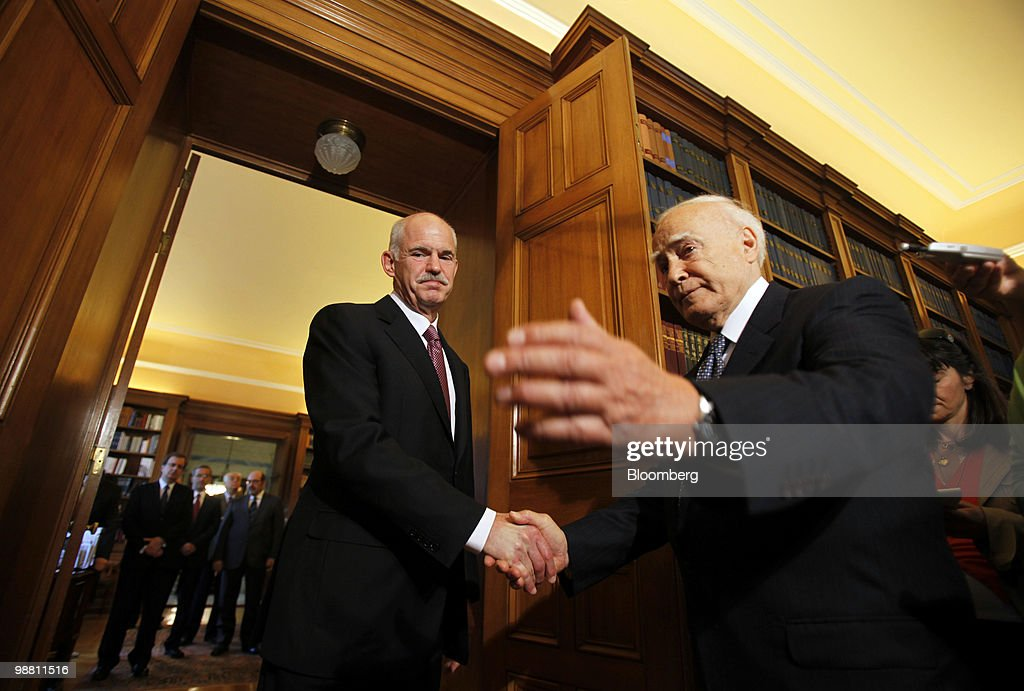 George Papandreou, Greece's prime minister, left, arrives for a meeting with Karolos Papoulias, Greece's president, at the presidential palace in Athens, Greece, on Monday, May 3, 2010. Papandreou's call for Greeks to accept more sacrifices in return for staving off default was rejected by opposition leaders and unions, which are already organizing more protests. Photographer: Kostas Tsironis/Bloomberg via Getty Images