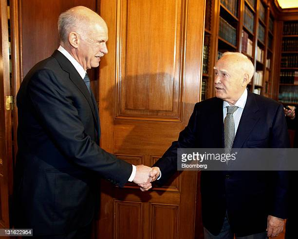 George Papandreou, Greece's prime minister, left, shakes hands with Karolos Papoulias, Greece's president, as Papandreou arrives for a meeting in...