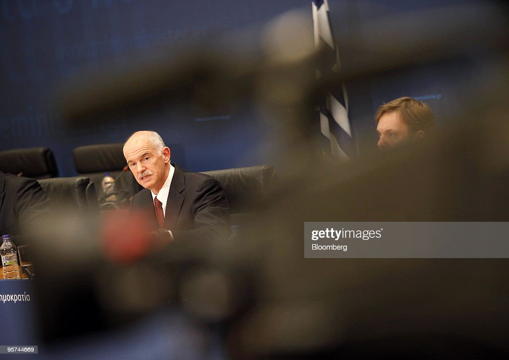 George Papandreou, Greece's prime minister, left, speaks at a press conference in Athens, Greece, on Wednesday, Jan. 13, 2010. Greece will not leave the euro or seek aid from the International Monetary Fund to reduce the European Union's biggest budget deficit, Papandreou said. Photographer: Kostas Tsironis/Bloomberg via Getty Images