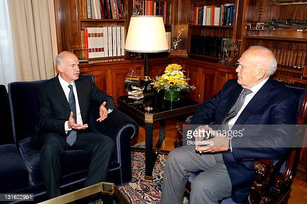 George Papandreou, Greece's prime minister, left, speaks during a meeting with Karolos Papoulias, Greece's president, in Athens, Greece, on Saturday,...