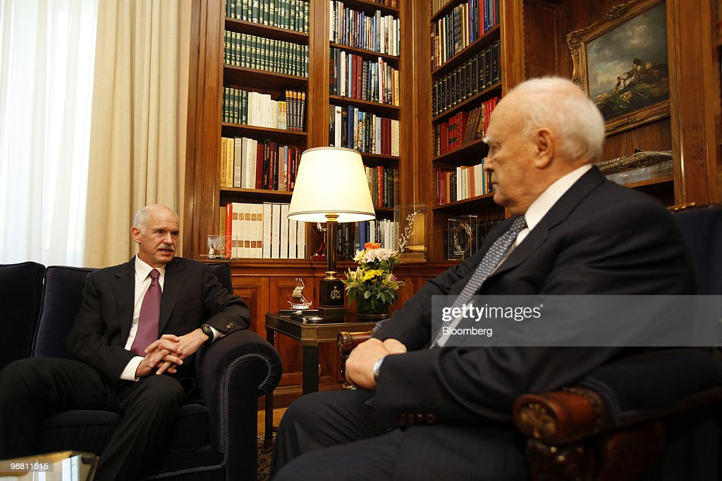 George Papandreou, Greece's prime minister, left, speaks during a meeting with Karolos Papoulias, Greece's president, at the presidential palace in Athens, Greece, on Monday, May 3, 2010. Papandreou's call for Greeks to accept more sacrifices in return for staving off default was rejected by opposition leaders and unions, which are already organizing more protests. Photographer: Kostas Tsironis/Bloomberg via Getty Images