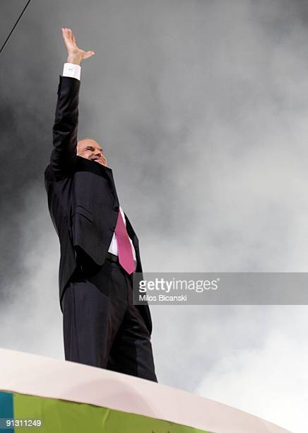 George Papandreou leader of Greece's Socialist Party waves to the crowd at a rally on October 1 2009 in Athens Greece Thousands of people attended...