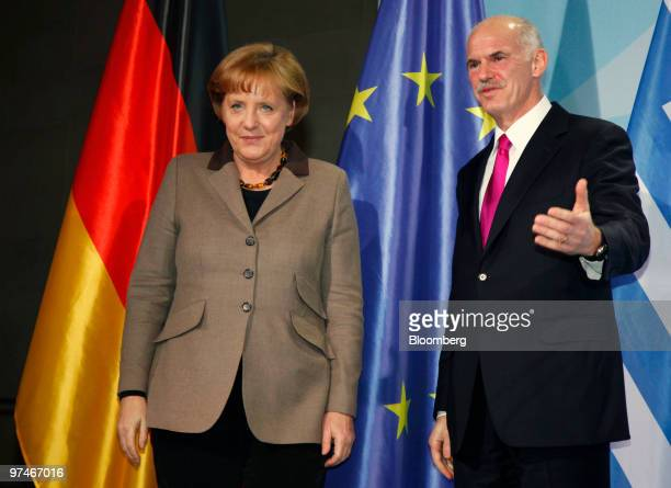 George Papandreou prime minister of Greece right and Angela Merkel Germany's chancellor depart the podium following a news conference at the German...