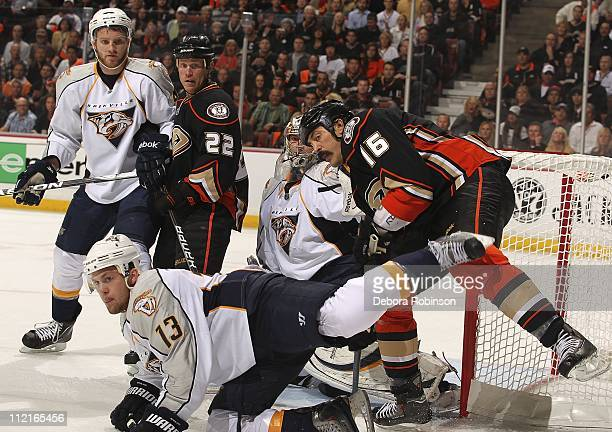 George Parros and Todd Marchant of the Anaheim Ducks defend in the crease against Nick Spaling Cody Franson of the Nashville Predators and Pekka...