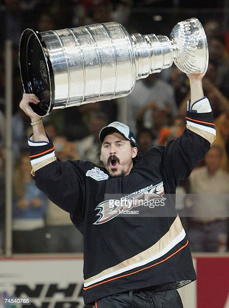 George Parros of the Anaheim Ducks hoists the Stanley Cup after his team's victory over the Ottawa Senators during Game Five of the Stanley Cup...