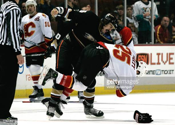 George Parros of the Anaheim Ducks throws a punch in a fight against Darren McCarty of the Calgary Flames during their game at Honda Center on...