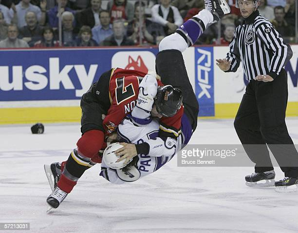 George Parros of the Los Angeles Kings is flipped over during a fight with Chris Simon of the Calgary Flames in the first period on March 29 2006 at...